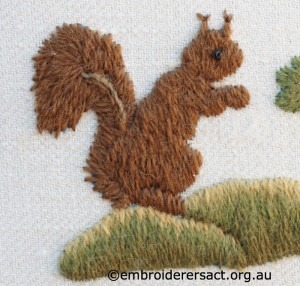 Detail 1 of Squirrel with Acorns stitched by Jillian Bath