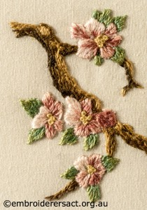 Detail 2 of Miniature Victorian Children on a Branch stitched by Evelyn Foster