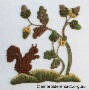 Squirrel with Acorns stitched by Jillian Bath