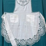 A white on white cotton Apron