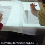 Young stitchers using lightbox