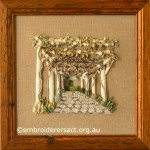 Framed version of Garden Avenue designed & stitched by Pat Bootland
