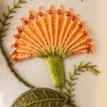 Orange needlewoven flower