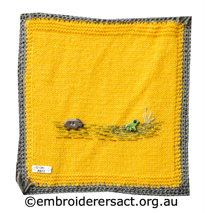 Knitted rug with embroidery